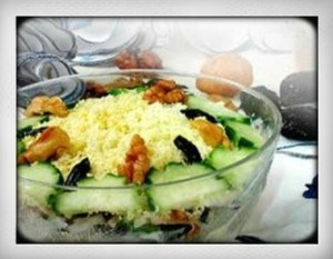 Traditional Russian salad Tenderness with chicken, walnuts, cucumbers and prunes