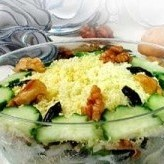Russian Tenderness salad with prunes, chicken and cucumbers